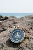 Compass and Ocean - Orientation Royalty Free Stock Photos