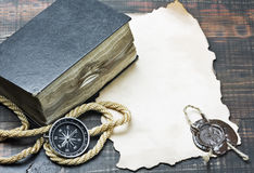 Compass and an old book Stock Photo