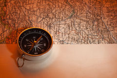 Compass and old foreign travel map Royalty Free Stock Photos
