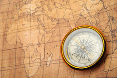 Compass on old map. Stock Photos