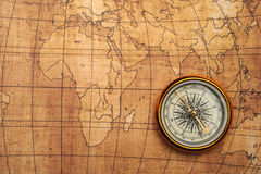 Compass on old map. Royalty Free Stock Image