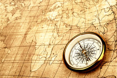 Compass on old map. Royalty Free Stock Photo