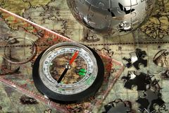 Compass on the old map Royalty Free Stock Photo