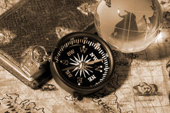 Compass on the old map Royalty Free Stock Photos