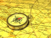 A compass on an old map. A magnetic compass on an old map Stock Images