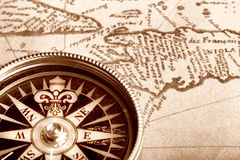 Compass on old map. Compass on old handwritten map of Haiti Stock Photo
