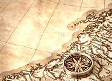 Compass on old map. Compass on the old map Stock Photo