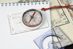 Compass and old maps Royalty Free Stock Photos