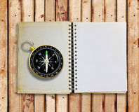Compass and old notebook Stock Images