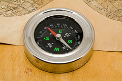 Compass with an old paper Royalty Free Stock Photos
