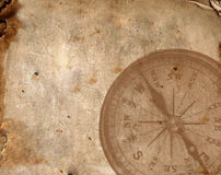 Compass on the old paper. Close up view of the Compass on the old paper background. Plenty of space for text Royalty Free Stock Photography