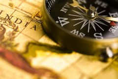 Compass on the old paper. Map is a drawing or plan of the surface of the earth that shows countries, mountains, roads, etc Royalty Free Stock Photography
