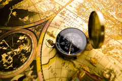 Compass on the old paper. Map is a drawing or plan of the surface of the earth that shows countries, mountains, roads, etc Stock Images