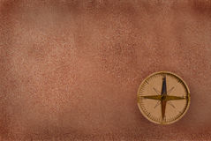 Compass on old paper. Compass on old brown paper background Royalty Free Stock Photos