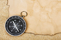 Compass on old paper against Royalty Free Stock Photos