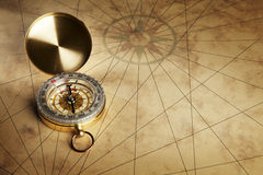Compass on the old paper background. Close up view of the Compass on the old paper background Stock Images