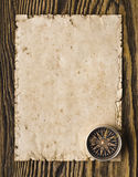 Compass on the old paper background.  Stock Image