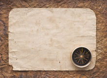 Compass on the old paper background.  Stock Images