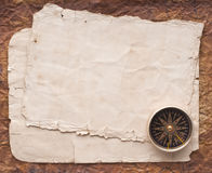 Compass on the old paper background.  Royalty Free Stock Image