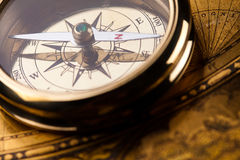 Compass on the old paper background.  Stock Photography