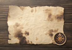 Compass on the old paper background.  Stock Photos