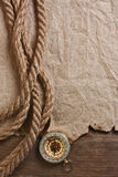 Compass, old paper and rope. Still-life Stock Photos