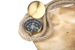 Compass, old paper and rope. Isolated on white background Stock Photos