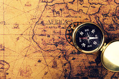 Compass on old vintage world map with copy space Stock Photography