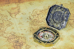 Compass on a old world map Stock Images