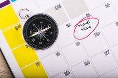 Free Compass On Planner Calendar With Word TRAVEL TIME Stock Images - 144798464