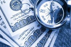 Compass on one hundred dollar Royalty Free Stock Image