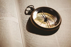 Compass on open bible Royalty Free Stock Image