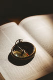 Compass on open bible Stock Photo