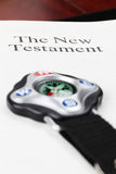 Compass on open New Testament Royalty Free Stock Images