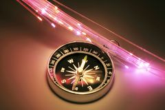 Compass with Optical Fibres. On Warm Background royalty free stock photo