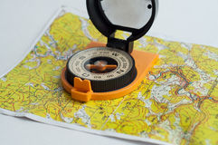 Compass and a map. Royalty Free Stock Photo