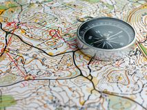 Compass on orienteering map. Copy space royalty free stock images