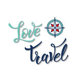 Compass and original handwritten text Love Travel Stock Image