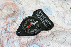 Compass over hiking map Stock Photos