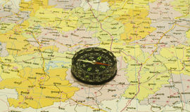 Magnetic Compass over Map Royalty Free Stock Images