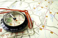 Compass over a trekking map. Color image Stock Photos
