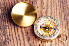 Compass over wooden background Stock Images