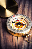 Compass over wooden background Royalty Free Stock Images