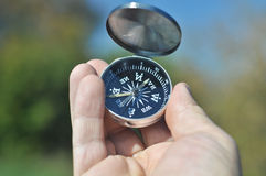 Compass in the palm of your hand. Stock Image