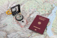 Compass and passport on a hiking map Stock Photos