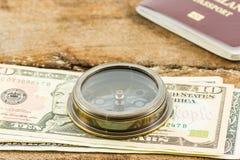 Compass, passport and money. Stock Photos