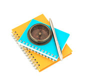 Compass  with   pen   on notebook  white background Royalty Free Stock Image