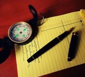 Compass pen and notebook Stock Photo