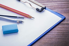 Compass pencil eraser clipboard and paper on Royalty Free Stock Photos