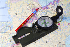 Compass, pencil and a fragment of the map of the North of Russia Royalty Free Stock Images